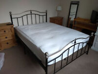 Stylish double bed and nearly-new mattress