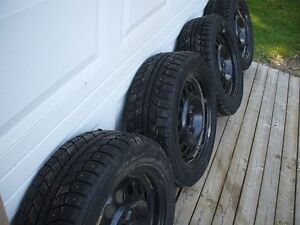 Four (4) Studded Winter Tires for Sale $400.00 FIRM