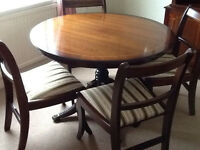 Mahogany finish dining suite: Circular table, 4 chairs, sideboard, bookcase/ cabinet, bureau.