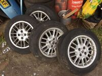 SET OF 4 ROVER ALLOY WHEELS 15 INCH WITH GOOD TYRES BARGAIN £85