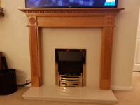 Electric fire and fire place with wood and polished stone/marble surround and plinth.