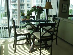 Glass table top dining room table with 4 chairs