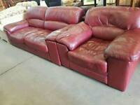 Red leather two seater sofa and armchair
