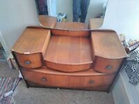 Vintage wooden dressing table with mirror and drawers.