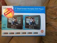 "Polaroid 7"" Dual screen portable dvd player. (Brand new, unused)"
