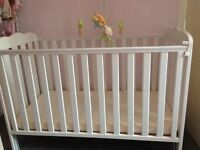 White cot with mattress
