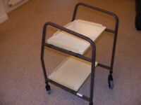 Roma Medical adjustable height trolley with wooden trays.