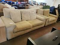 Large beige fabric sofa with matching armchair
