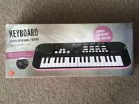 Clifton children's piano in box with instructions