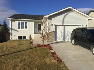 4 bedroom .house, garage, pet friendly north of cochrane