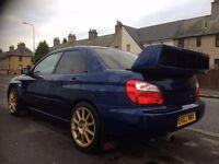 Subaru Impreza 1.6GL non turbo.