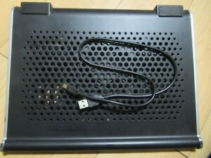 COOLER WITH BUILT IN SPEAKERS FOR A LAPTOP