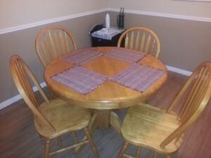 Oak table, leaf and 4 chairs.