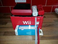 Red Nintendo Wii Mini, Wii Sports Game, Nunchuck and 2 Remotes Boxes Included