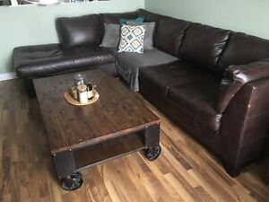 Dark brown faux leather sectional. 4 years old.