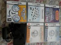 DS Lite (black) with stylus, charger and 5 games