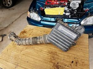 OEM Honda, 92-95 civic intake arm/filter housing.