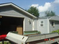 3bdrm mobile home for sale with 1200 square ft detached garage.