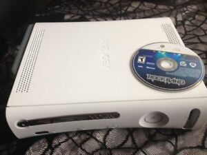 Xbox 360 with Rockband disc