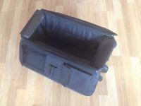 Black imitation leather wheeled luggage bag with handle
