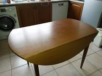 Round kitchen/dining drop-leaf table