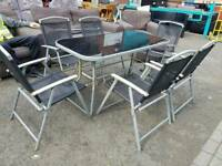 Garden patio table and 6 black mesh chairs