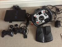 PS2 with 23 games, 2 controllers and Steering Wheel