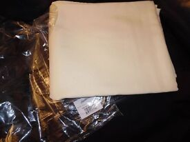 12 brand new table cloths in ivory