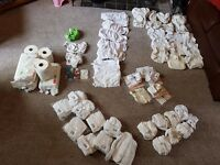 Huge cloth nappy starter kit. 33 nappies,12 wraps and other bits.