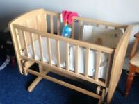 Two months Used Gliding crib from new born baby to six months