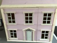 old wooden dolls house
