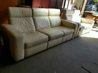 Cream leather three seater and two seater reclining sofa suite in good condition