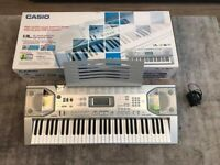 Casio CTK-800 electric keyboard with two books
