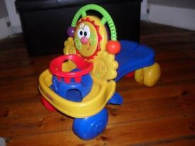 Toddlers baby walker/sit on toy with lights and sounds.