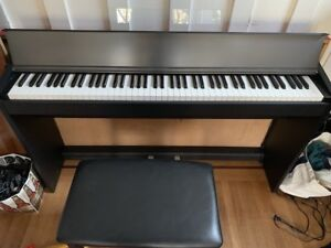 Roland F-100 Digital Piano and bench. lightly used.