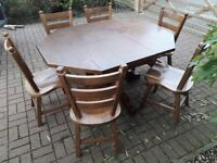 Lovely chunky pedestal solid oak extendable table and 6 chairs, excellent condition £260 Redcar Ings