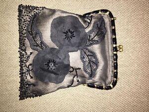 Black beaded silk clutch