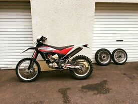 Husqvarna TE449 2013 model not a Honda Yamaha or Susuki. extra parts super-moto wheels ac exhaust