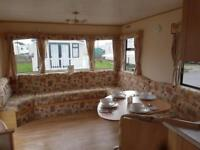 Cheap static caravan sited on robin hood north wales,next to beach,pet friendly