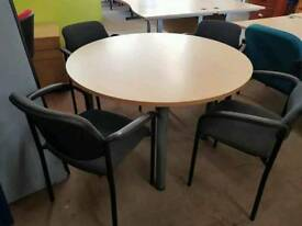 Round meeting table and four chairs