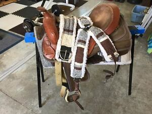 Western saddle with pad, chest plate and cince