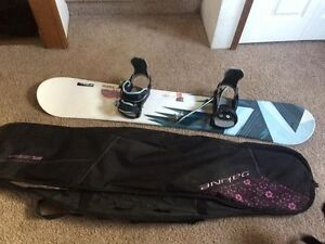 Snowboard, bindings, bag