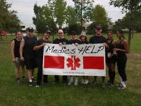 Female softball player for Paramedic charity tournament