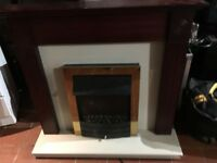 Gold Electric fire and surround 3 different warming settings can deliver