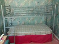 Silver metal single bunk beds with one mattress
