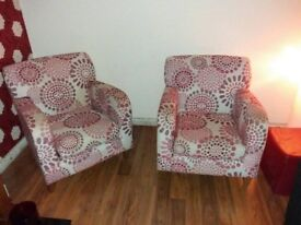 Red and cream armchairs.