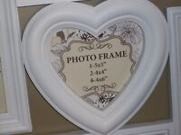 LARGE WHITE MULTI FRAMED PIC FRAME BRAND NEW IN BOX .