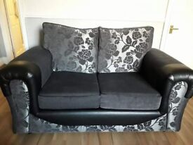 2 Two seater sofas
