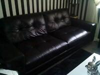 As new 3/4 seater and 2 seater plus pouffee in black real leather
