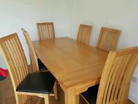 Solid wood dining room table & 6 chairs